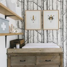Change table area Change Table: @incy_interiors from @ryderlovesmiller Artwork: @hellopants Storage Sacks: @minimaliststyle Baby First Aid Box: @tinyheartsfirstaid Wallpaper: @cole_and_son_wallpapers @karinajadephotography