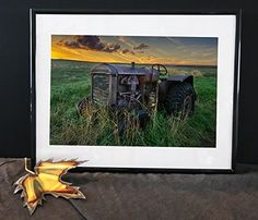 "Framed Photographic Print - Abandoned Tractor at Sunrise - Fine Art Landscape Photography from Alberta, Canada. I am the owner of Gathering Dust Photography Company located in Lethbridge, Alberta, Canada. It is my passion to shoot nature, wildlife and abandoned farmsteads in and around this beautiful province that I call home. This listing is for an 8"" x 12"" framed photographic print of an abandoned tractor at sunrise on the prairies. It is an old McCormick-Deering. It is framed with a…"