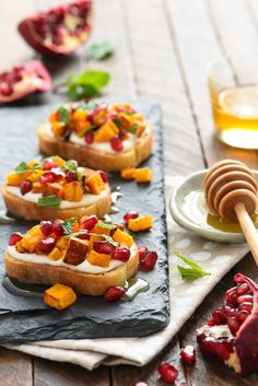 Butternut Squash & Pomegranate Crostini with Whipped Feta and Honey - This autumn appetizer is the perfect balance of sweet and savory. Set these out at your next party and watch them disappear!   foxeslovelemons.com