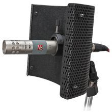 The Reflexion Filter is a portable device for recording live sound sources with reduced room ambience. It is an advanced composite wall which is positioned behind any microphone by means of a variable position stand clamp assembly which ships with the product. The main function is to help obtain a 'dry' vocal or instrument recording. This is especially useful in studios without proper acoustic treatment, but can also be used to help record takes in control rooms.
