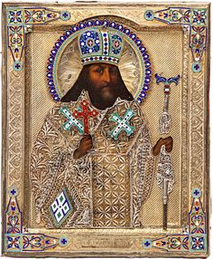 A RUSSIAN ICON OF SAINT FEODOSY CHERNIGOVSKY IN A GILT SILVER AND ENAMEL OKLAD, MOSCOW, 1880S, the intricate oklad has an engine turned ground, Saint Feodosy's robes articulated in delicate filigree, the spandrels, crown, halo and robe ornaments with applied plaques of elaborate cloisonné enamel.