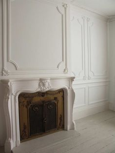 Absolutely beautiful fireplace and wall panels.
