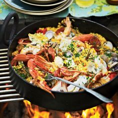 To cook this delicious seafood-and-chorizo paella, chef Pete Evans uses his grill as both a stovetop and an oven, simultaneously using direct and indirect heat.