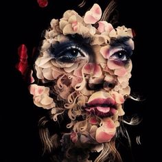 Lady with flower petals shaping face.  Graphic design.    http://creativitybubbles.com/