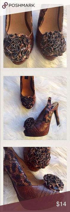 """Brown leopard platforms. 6 1/2. By Cabi 4"""" heel and close to one inch platform beautiful  brown platforms. Textured brown man made leather heels with ruffled flower on top. Faux animal print and snake texture. So cute!!!! Size 6 1/2! CAbi Shoes Platforms"""