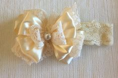 Gorgeous is the only way to describe this bow. It is a cream satin ribbon & lace bow attached to a lace headband.