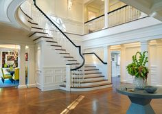 Amazing staircase AND look at that dining room!