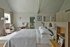 This is what oversize bedroom looks like when bed is moved away from headwall and a wardrobe is built in. Contemporary Bedroom by Sims Hilditch.