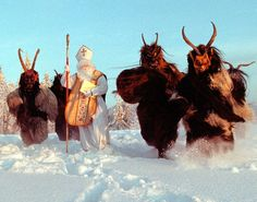 Men dressed in costumes of St. Nikolas and Krampus walk through the snow near Salzburg, Austria on November 30, 1998. On St. Nikolas day, December 6, the Krampusse traditionally punishes the children for bad behaviour during the year, while Saint Nikolas brings sweets and small presents. (Reuters)