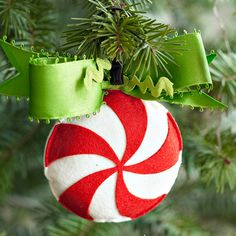 Classic peppermint-swirl candy makes for great ornament inspiration! More ideas for felt Christmas ornaments: www.bhg.com/christmas/crafts/make-christmas-ornaments-with-felt/?socsrc=bhgpin100912peppermintornament#page=11