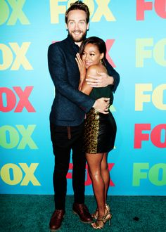 Sleepy Hollow cast members Tom Mison and Nicole Beharie arrive on the red carpet during the FOX 2014 FANFRONT