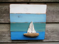 Its a great day for sailing! I created this Nautical Wood Wall Hanging from recycled, reclaimed wood. The sailboat is crafted from driftwood