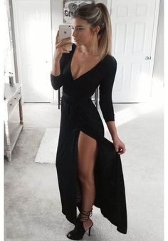 Farrah black maxi dress with plunging neckline and high leg slit.