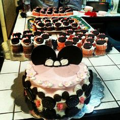mini mouse cake and cupcakes strawberry and used oreos for face and piped pink bow on cupcakes super cute and easy