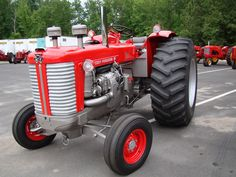 In a complete departure from the Minneapolis Moline-based MF 95/95 Super/97, was the 1960-1962 Massey Ferguson 98. It was an Oliver 990 in MF clothing. Whereas the MF 95-97 tractors were as long as a locomotive, and mellow-sounding, the MF 98 was stubby and obnoxious, powered by a supercharged 2 cycle 3-71 Detroit Diesel, 'Screaming Jimmy'. It was a no-nonsense, no-apologies BULL of a tractor, and could weigh in at a massive 15000 pounds.