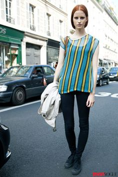 This outfit might be #simple, but the model complements her red hair perfectly with a sheer striped top in shades of blue and yellow.