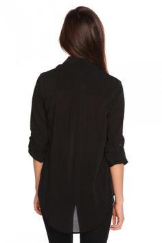 this is such a great staple. a long button down blouse. i love that it's sheer.