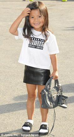 Aila Wang with a kid-size Balenciaga bag and a leather miniskirt ... she's 4!