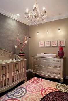 Baby girl room - Wow!  I would never think to do silver on a crib, but I love the mix of traditional and contemporary, plush and industrial such a nice mix to make an elegant cozy room