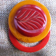Bakelite button pin.