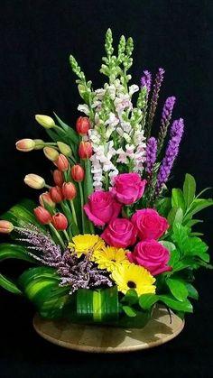 Floral arrangement with gerbera daisies, liatris, snapdragons, tulips, and Heather. Arrangements Ikebana, Large Flower Arrangements, Funeral Flower Arrangements, Large Flowers, Exotic Flowers, Flower Centerpieces, Amazing Flowers, Silk Flowers, Flower Decorations