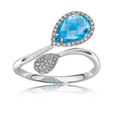 This striking pear-shaped blue topaz ring features 50 hand-set round brilliant diamonds, in 14 karat smooth white gold.