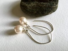 - Power Pearls - Brilliant white, full-bodied Swarovski crystal pearls are wire-wrapped and suspended on long, lean, gently-curving ear wires (about 1-7/8 inches long). The... #trending #etsy #etsymntt