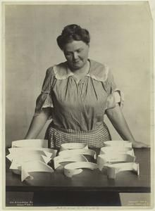 Woman worker and various styles of Arrow collars, United States,1906.] (c1906)   New York Public Library