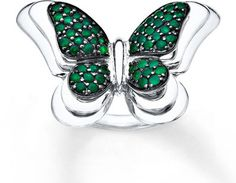 7bf3bdb623a658 Spread your wings and fly in style with this charming butterfly ring  featuring round lab-created emeralds set in sterling silver.