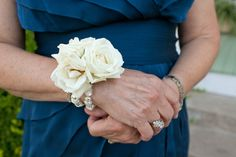 I also just love the idea of an ivory plain roses for the moms/grandmothers as they'll be wearing all different colors