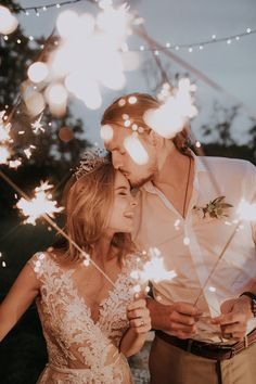Love love love this sweet sparkler moment between these two newlyweds | Image by aLinda Lauva Photography