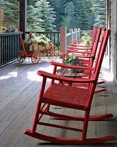 Nice wide porch with pretty red rockers..family time after dinner.I could see these on my front porch overlooking the lake....