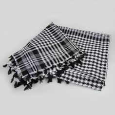 """Tactical White & Black Shemagh Arab Desert Keffiyeh Cotton Scarf by DYZ. $4.99. Design -  Tassels Around. Size - 46"""" by 46 """" - 117cm by 117cm. Color: Black and white. Weight -5.64 oz. Essential For Protecting Eyes, Nose, Mouth, And Neck From Sand. Scarf is high quality stitch. Worn by soldiers in Iraq and Afghanistan and abroad. Retains heat and absorbs sweat in warm/hot conditions. It can also Used by soldiers worldwide for protection, and celebrities around the..."""