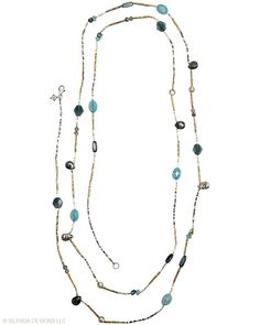 Dainty, yet perfectly punctuated. Quartzite, Shell, Larvikite, Kyanite, Glass, Brass, Sterling Silver.