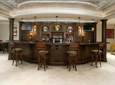 not sure about the brick behind the bar, maybe stone or a subway tile BUT love the chocolate wood, curved bar top and amazing ceiling!