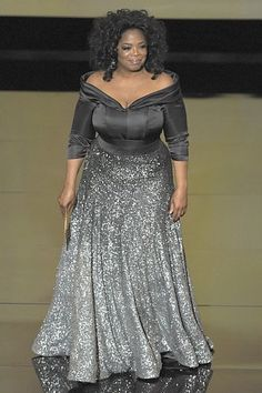 Presenter Oprah Winfrey speaks onstage during the 83rd Annual Academy Awards held at the Kodak Theatre on February 27, 2011 in Hollywood, California. Zac Posen gown.