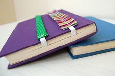 DIY Elastic Bookmark http://craftsnob.com/2011/09/book-decor-pretty-bookmarks-and-journal-wraps/