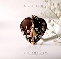 Mother. Beautiful handmade hand appliqued polymer clay pendant. Made to order by Eva Thissen Gallery, via Flickr