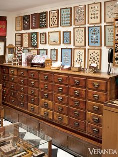 An old library card catalog is re-purposed into a trendy cabinet in this button store. This would be a great idea in a sewing room for all your fabric! Discount Furniture, Interior Styling, Interior Design, Old Libraries, Library Card, Displaying Collections, Sewing Rooms, Craft Storage, Makeup Organization