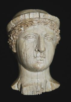 Ivory female head, front.       Roman Period - 200BC-100