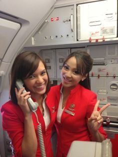 "Air Asia & Flight Attendants in control. ""Yes, Captain, no need to divert the flight!"" Why? Because these girls have him all tied up and safely stowed in the galley."