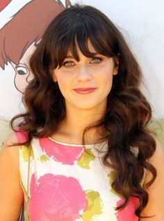 Zooey Deschanel. My hair looked like hers a few months ago. Comfy and cute.