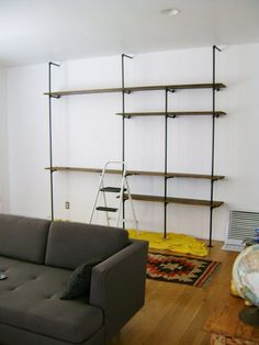 Some seriously cheap, seriously cool, and seriously customizeable shelving units... just need 1/2' pipes, some plumbing fittings and some wood planks.  I LOVE IT!