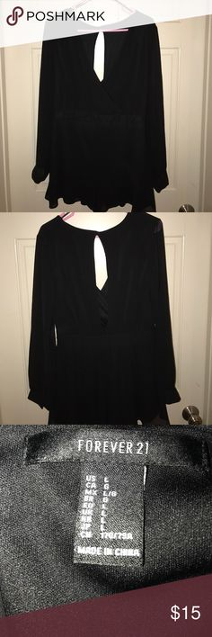 Black Romper Black Romper with sheer long sleeves and a key hole in the back....has an elastic band waist. it is a large, but runs more like a medium. Forever 21 Dresses