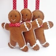 This handsome trio of gingerbread men are hand stitched by little old me in a corner of gorgeous Devon, England.  Each gingerbread man is made with felt, finished with ric-rac 'icing' and has a smart polka-dot bow tie! They are lightly stuffed with pol...