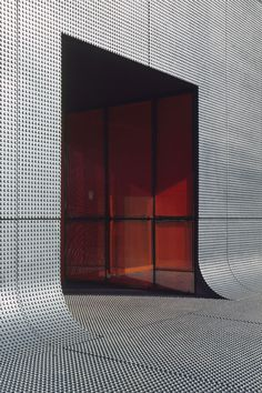 The RATP Bus Center, in France, by ECDM Architects has embossed dots on its concrete facade, which makes it look like a perforated metallic building from some angles and a giant LEGO block from others. Architecture Arc, Airport Architecture, Concrete Architecture, Amazing Architecture, Contemporary Architecture, Installation Architecture, Concrete Facade, Innovative Architecture, Cultural Architecture