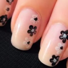 "side flowers are a classy look...the base coat is the same base coat of a french tip nail, then follow the ""how to make flowers"" on my board"