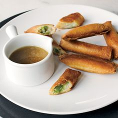 Mashed-Potato Spring Rolls | David Chang took F&W's Thanksgiving challenge by improvising a Momofuku-style feast from basic leftovers, including turning mashed potatoes and green beans into this crispy canapé, a salute to the 1950s.
