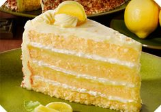 This cake contains a rich lemon filling and real whipped cream between four layers of genoise. Finished with lemon French butter crème, and delightfully decorated with qroqant and candied lemon slices Yummy Treats, Delicious Desserts, Sweet Treats, Yummy Food, Bolo Genoise, Candied Lemon Slices, Brownie Cake, Cupcake Cakes, Cupcake Ideas