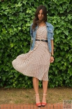 I like the dress, but I like the casual jean jacket with it too. Also, I like the belt that defines her waist.